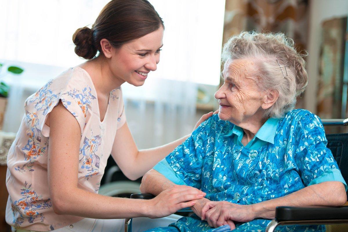 Woman Comforts Senior Woman