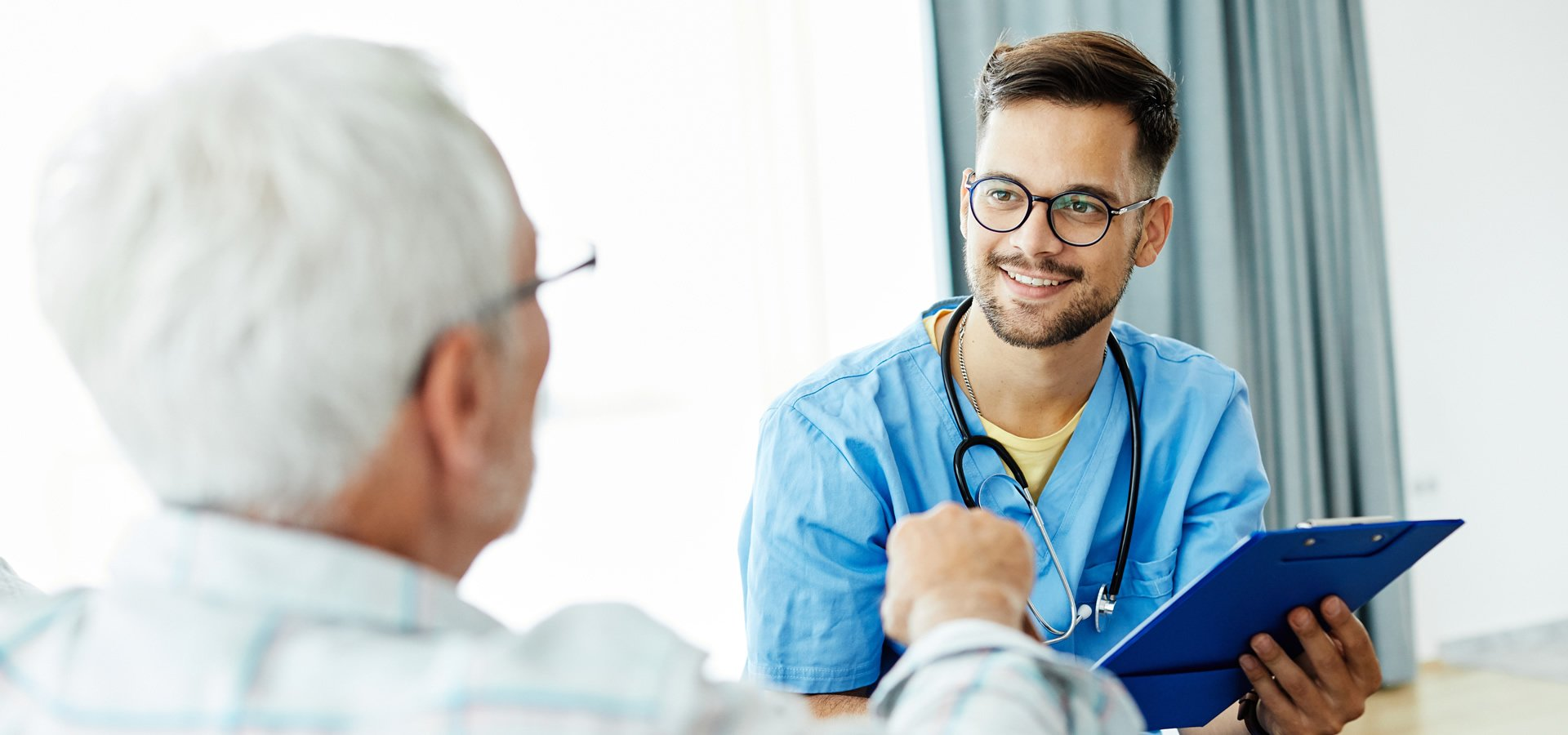 Male doctor with Senior Male